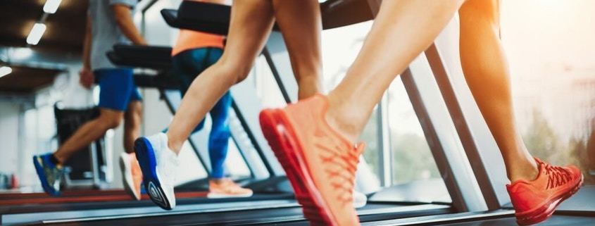Athletic peoples focused on running at gym